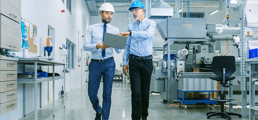 two person walking in a factory office
